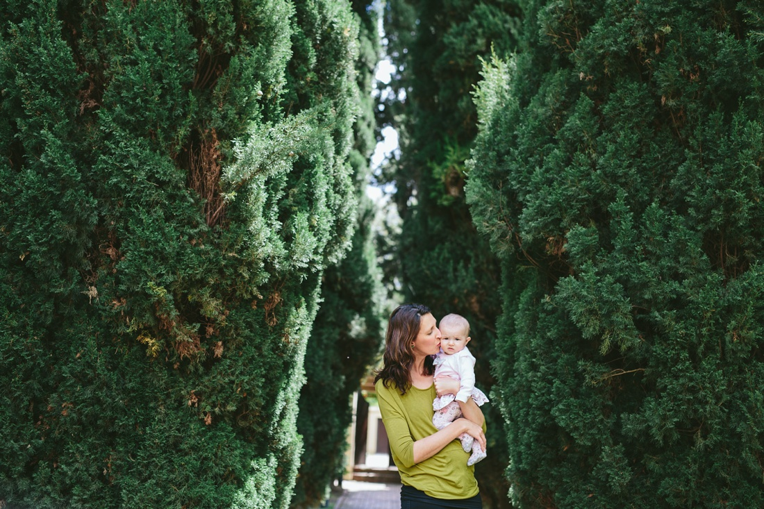 an image taken by Vividblue of a mother and her baby between big hedges