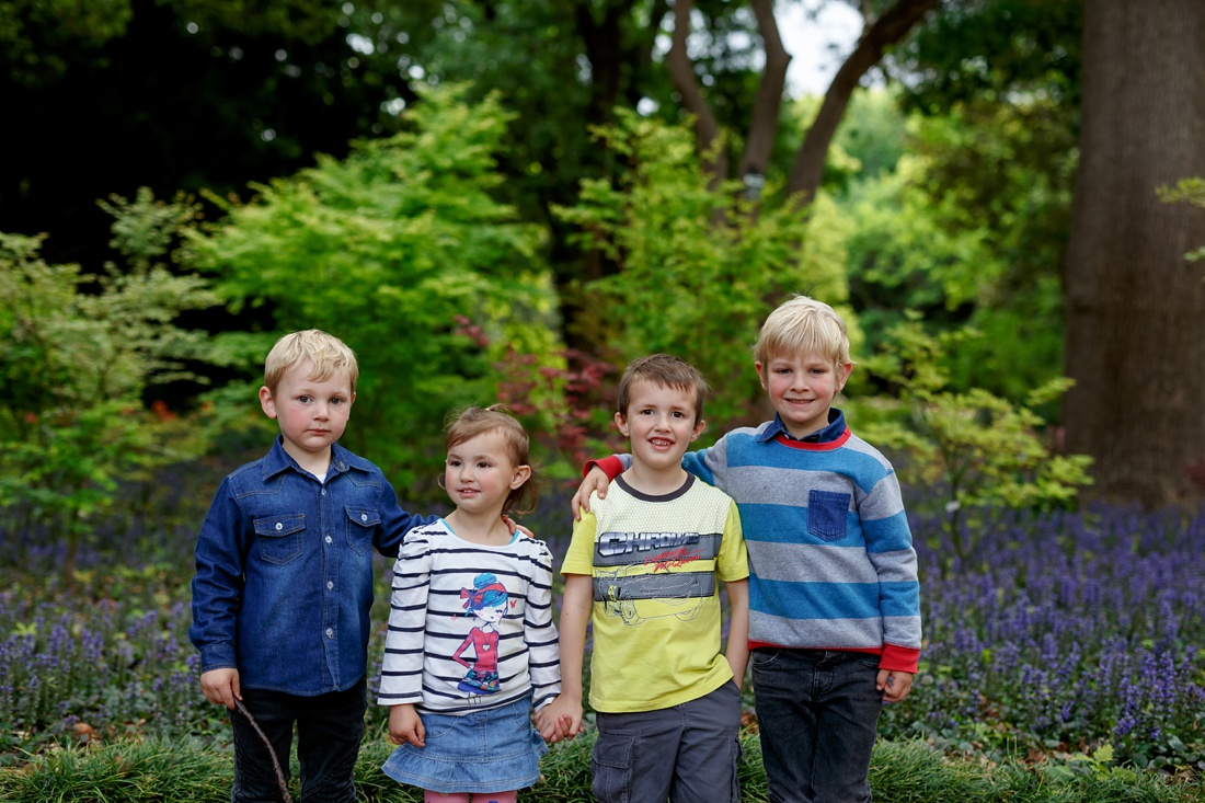 an image taken by Vividblue of four Kids standing with their arms around each other smiling