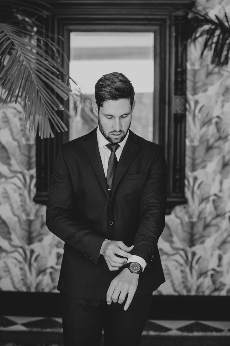 a black and white image of the groom getting ready for the wedding at Molenvliet