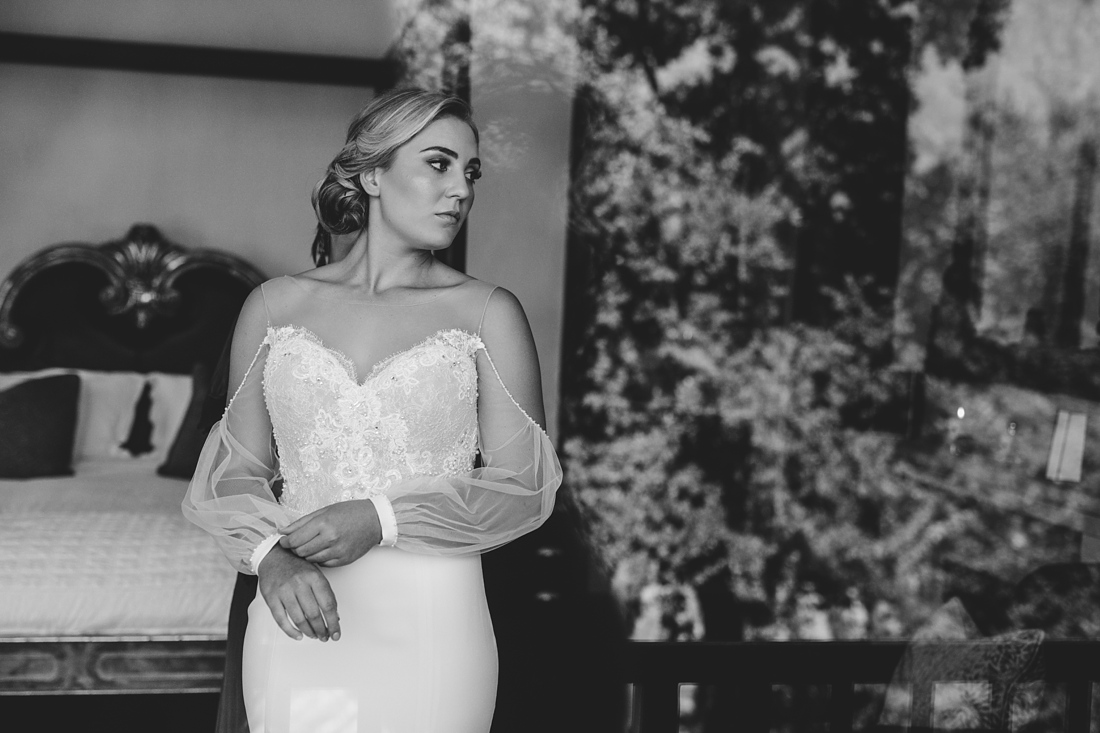 an image taken by Vividblue of a bride with a tight fitted dress with open sleeves.