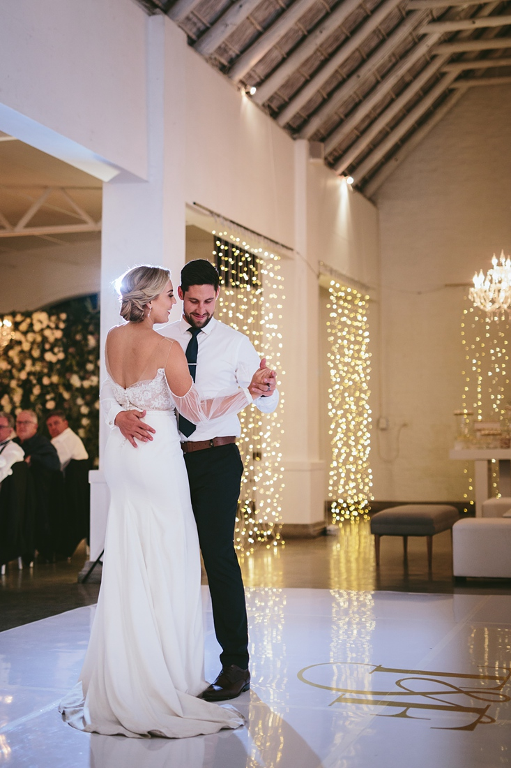 an image taken by Vividblue of the bride and groom having their first dance at Molenvliet.