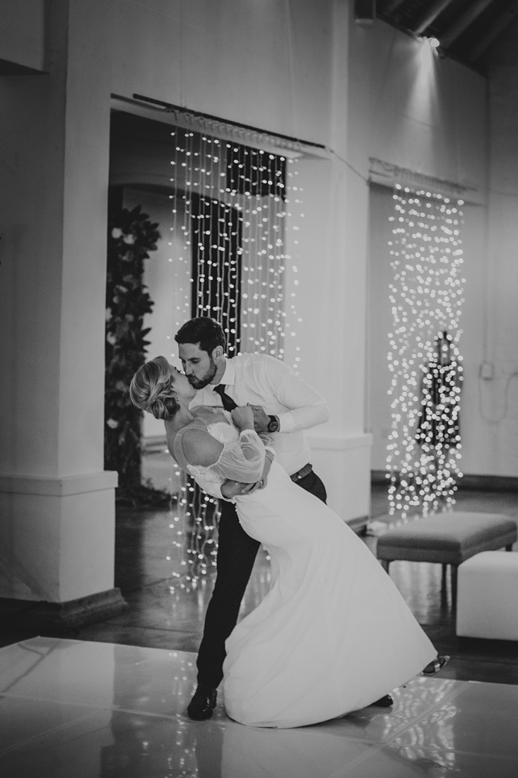 a black and white image taken by Vividblue of the bride and groom kissing during their first dance at Molenvliet.