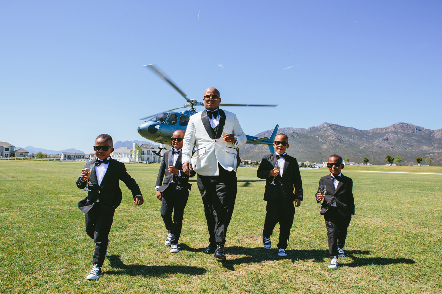an image taken by Vividblue of the groom and and kinds walking from the landed helicopter at Val de Vie