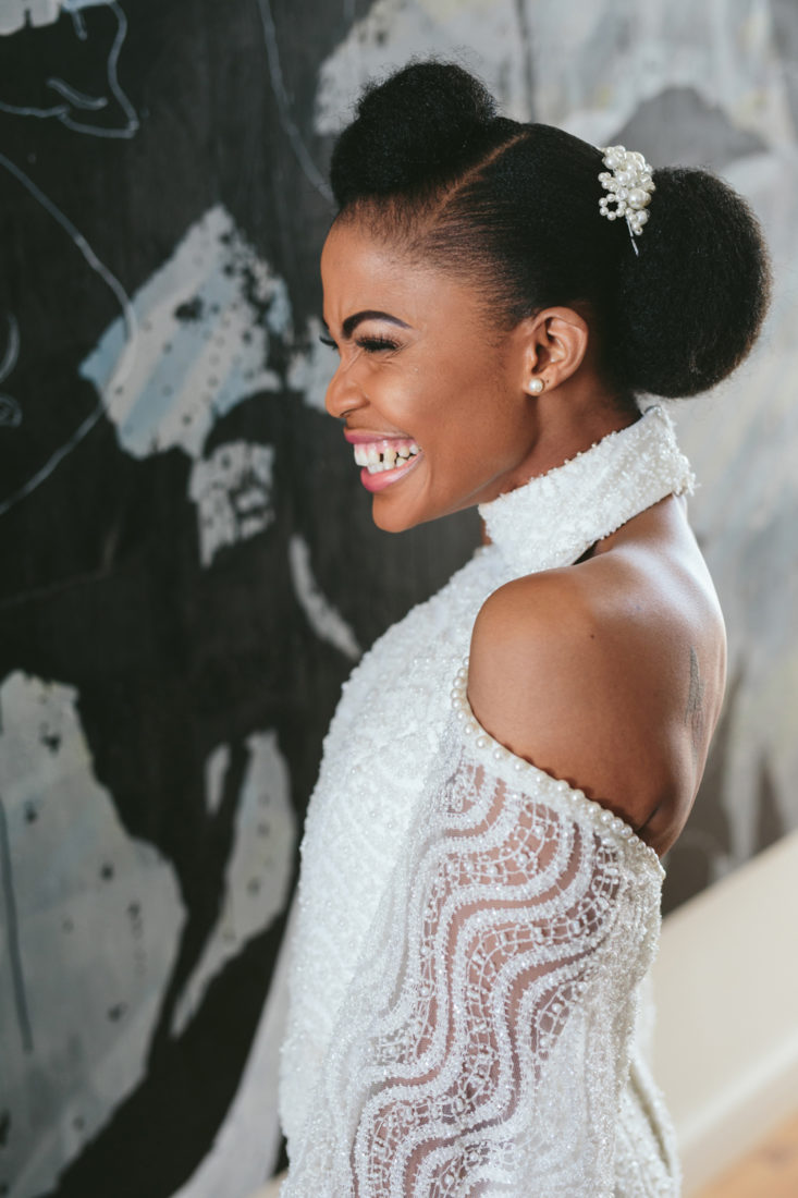 an image taken by Vividblue of the bride smiling in her lace wedding dress at Val de Vie.