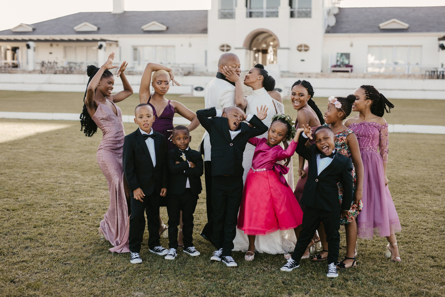 an image taken by Vividblue of the bridal party and kids doing a funny pose.