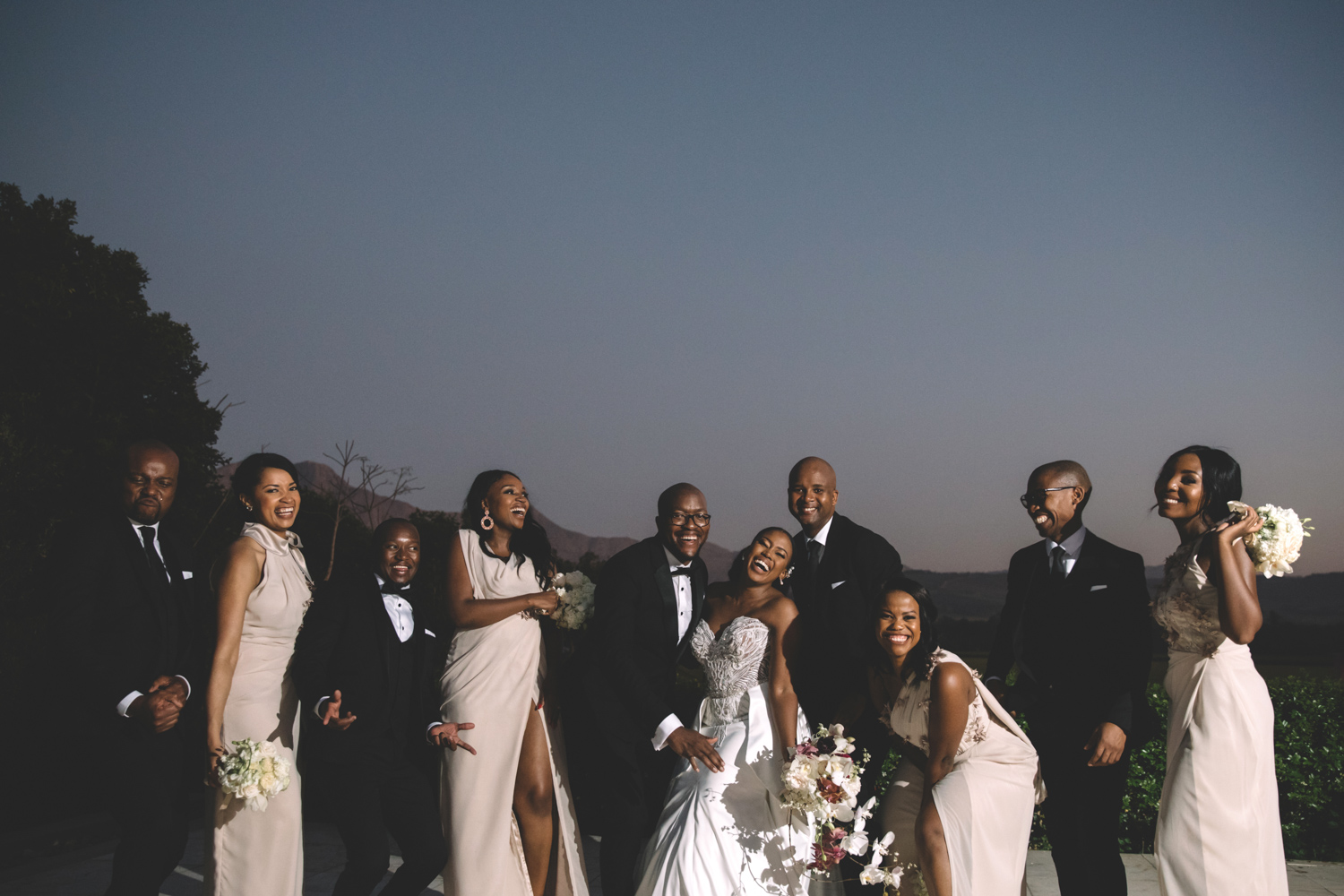 The bridal party smiling and having fun on the Lourensford wine estate