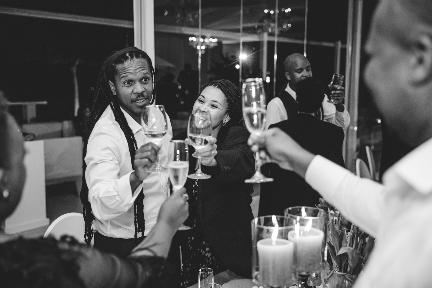 Wedding guests having fun and toasting  to the newly married couple on the Laurent venue Laurensford.